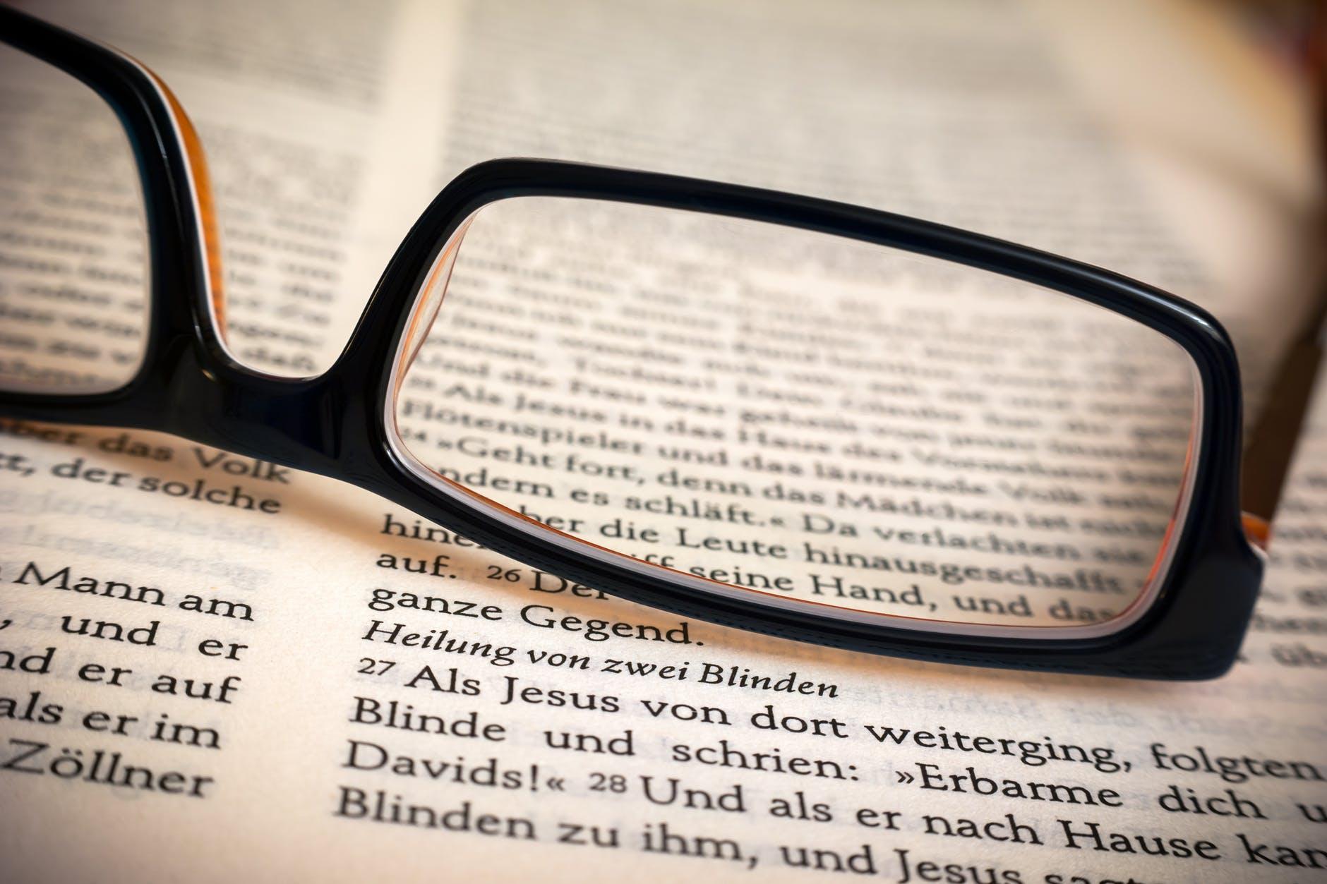 bible book close up eyeglasses